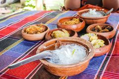 Thai rice in ice water put cup of clay for appetizers place on table stock image