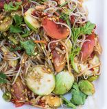 Papaya salad. Thai rice noodle papaya salad with pickled fish sauce Stock Photo