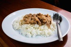 Thai rice with pork curry. On the table Stock Photos