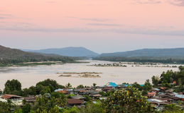 Thai riverside village at sunset Stock Photos