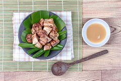 Thai roasted banana with sweet sauce royalty free stock images
