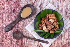 Thai roasted banana with sweet sauce royalty free stock photos
