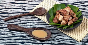Thai roasted banana with sweet sauce stock photography