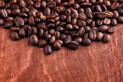 Thai roasted coffee beans on wooden background Stock Photography