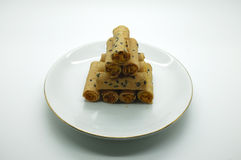 Thai rolled wafer stacking on dish Royalty Free Stock Photo