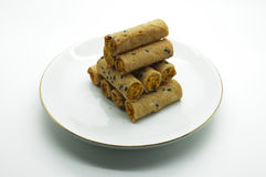 Thai rolled wafer stacking on dish Royalty Free Stock Photos