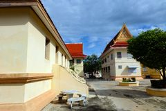 Thai Roof Buddhist Temple Art Style Construction with Blue Sky Clouds of Thailand Stock Photo