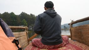 Thai rower waterman rowing bamboo rafts in Pang Ung lake for service travelers