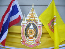 Thai Royal Emblem and Flags Stock Photo