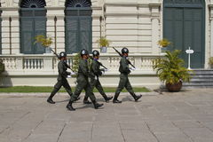 Thai Royal Guards Marching in the Royal Grand Palace, Bangkok. Royalty Free Stock Image