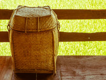 Thai rustic handcraft picnic rattan wicker basket and wooden flo Stock Image