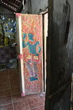 Thai`s painted on the door.Wat Si Po Chai,Na Haeo District,Loei Province,Thailand. Royalty Free Stock Photo