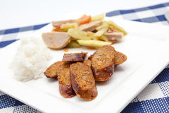 Thai salad with cucumber and spicy sausage and steam rice. Thai Cucumber Salad Tam Taeng whit spicy sausage Royalty Free Stock Images