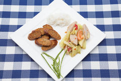 Thai salad with cucumber and spicy sausage and steam rice. Thai Cucumber Salad Tam Taeng whit spicy sausage Royalty Free Stock Photography