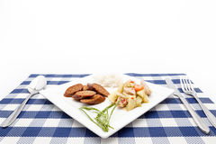 Thai salad with cucumber and spicy sausage and steam rice. Thai Cucumber Salad Tam Taeng whit spicy sausage Stock Images