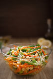 Thai salad of sliced raw carrot noodles and cucumber in sweet and sour sauce. Thai salad from noodles raw carrots and cucumber with chickpeas, cilantro and royalty free stock image