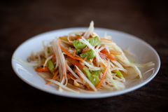 Thai salad Som Tam. Fresh made hot papaya salad Som Tam with bean, carrot and peanuts. Traditional thai cuisine Stock Image