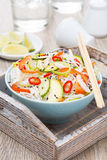 Thai salad with vegetables, rice noodles and chicken in bowl Stock Image