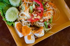 Thai salted egg papaya salad. Fresh prepared asian spicy Som Tam papaya salad served with salted eggs in local restaurant on Koh Lanta island. Traditional thai royalty free stock photo