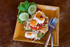 Thai salted egg papaya salad. Fresh prepared asian spicy Som Tam papaya salad served with salted eggs in local restaurant on Koh Lanta island. Traditional thai royalty free stock photos