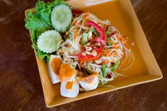 Thai salted egg papaya salad. Fresh prepared asian spicy Som Tam papaya salad served with salted eggs in local restaurant on Koh Lanta island. Traditional thai stock image
