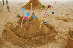 Thai sand pagoda. Small Thai traditional sand pagoda with colorful flags in Songkran festival stock image