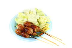 Thai sausage. With green cabbage isolated on white background Stock Image