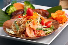Thai Sausage with Som Tum Salad. Traditional dish of freshly prepared Thai food.  Thai Sausage and som tum green papaya salad Stock Image