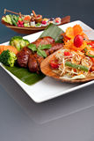 Thai Sausage with Som Tum Salad. Plate of freshly prepared Thai sausage and som tum green papaya salad Stock Photography