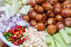 Thai Sausage Style, Sausage Northeastern Style served in a dish with side dishes Stock Photo