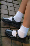 Thai schoolgirl's shoe. Thai girls wear a black leather shoes as a school uniform Stock Photography
