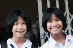Thai schoolgirls in uniform. UBON RATCHATHANI, THAILAND - MAY 6 Unidentified Thai schoolgirls in uniform smile to camera on May 6,2013 in Ubon ratchathani stock photos