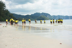 Thai schoolkids playing at the beach Stock Photos
