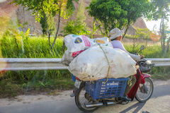 Thai scooter carrying giant bags Stock Photos