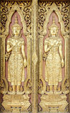 Thai sculpture style on temple door Stock Photos