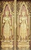 Thai sculpture style on temple door Stock Photos