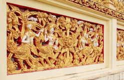 Thai sculpture on the temple wall Royalty Free Stock Photo