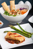Thai Sea Bass Seafood Dinner. Freshly prepared Thai style sea bass fish dinner with asparagus and appetizer with a contemporary presentation royalty free stock photos