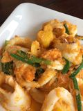 Thai sea food. STIR-FRIED SQUID WITH SALTED EGG YOLK stock photography