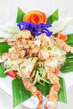 Thai seafood, crap salad with flowers decoration Stock Photo