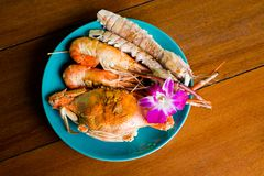 Thai seafood mix selection barbecue. Thai seafood mix barbecue selection of crayfish, prawns and crab in local port restaurant. Traditional thai seafood cuisine stock image