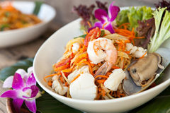 Thai Seafood Som Tum Salad. Traditional dish of freshly prepared Thai food.  Thai seafood and som tum green papaya salad Royalty Free Stock Photo