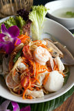 Thai Seafood Som Tum Salad. Traditional dish of freshly prepared Thai food.  Thai seafood and som tum green papaya salad Stock Photo