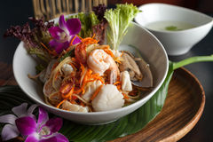 Thai Seafood Som Tum Salad. Traditional dish of freshly prepared Thai food.  Thai seafood and som tum green papaya salad Royalty Free Stock Image
