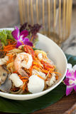 Thai Seafood Som Tum Salad. Traditional dish of freshly prepared Thai food.  Thai seafood and som tum green papaya salad Royalty Free Stock Photography
