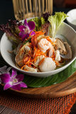 Thai Seafood Som Tum Salad. Traditional dish of freshly prepared Thai food.  Thai seafood and som tum green papaya salad Royalty Free Stock Images