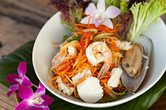 Thai Seafood Som Tum Salad. Traditional dish of freshly prepared Thai food.  Thai seafood and som tum green papaya salad Stock Image