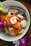 Thai Seafood Som Tum Salad. Traditional dish of freshly prepared Thai food.  Thai seafood and som tum green papaya salad Royalty Free Stock Photos