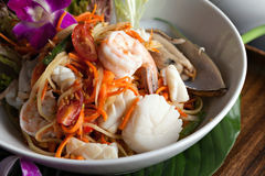 Thai Seafood Som Tum Salad. Traditional dish of freshly prepared Thai food.  Thai seafood and som tum green papaya salad Stock Photography