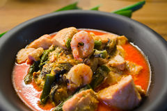 Thai seafood soup. Thai soup with salmon, prawn and oyster Stock Images